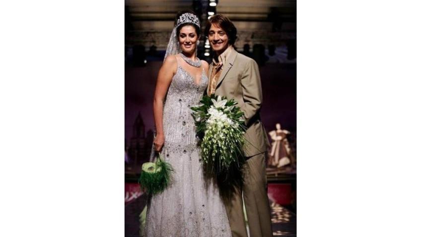 غادة عبد الرازق بفستان الزفاف في عرض أزياء هاني البحيري
