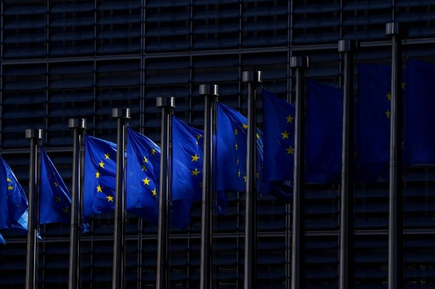 A picture taken on May 28 in Brussels shows the European Union flags fluttering in the aire outside the European Commission building in Brussels. (Photo by kenzo tribouillard / AFP)