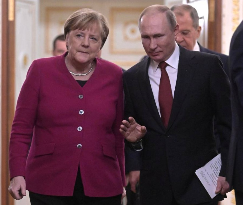 Russian President Vladimir Putin and German Chancellor Angela Merkel arrive for a joint news conference in the Kremlin in Moscow, Russia, January 11, 2020. Sputnik/Sergei Guneev/Kremlin via REUTERS ATTENTION EDITORS - THIS IMAGE WAS PROVIDED BY A THIRD PARTY.