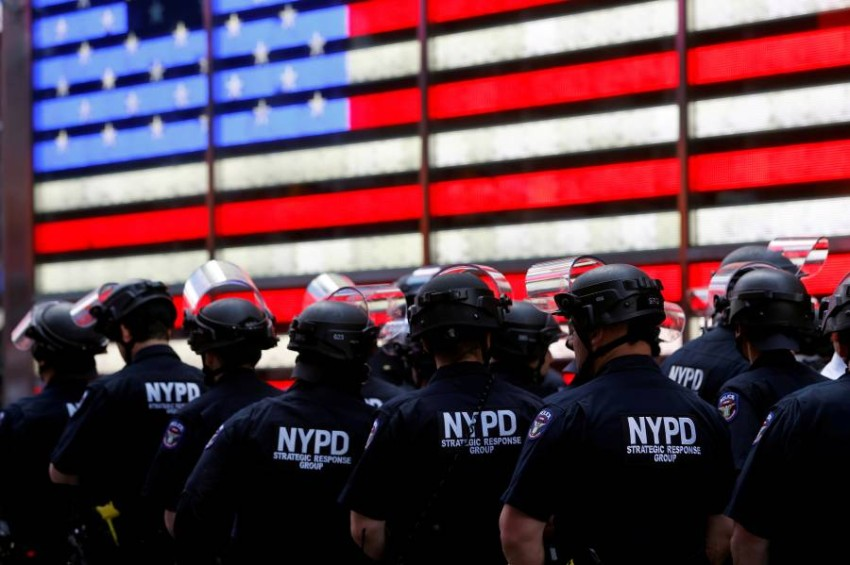 FILE PHOTO: New York Police Department (NYPD) officers are pictured as protesters rally against the death in Minneapolis police custody of George Floyd, in Times Square in the Manhattan borough of New York City, U.S., June 1, 2020. REUTERS/Mike Segar/File Photo