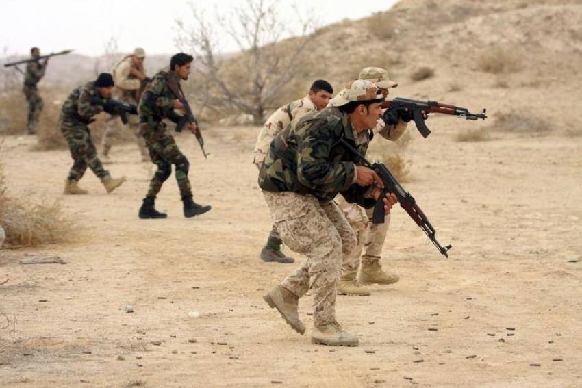 القوات العراقية والحشد. (رويترز)