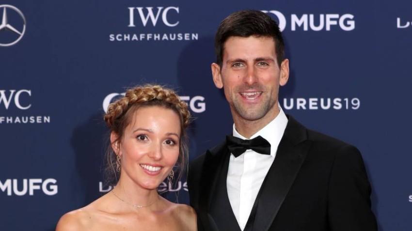 ديوكوفيتش وزوجته. (رويترز)