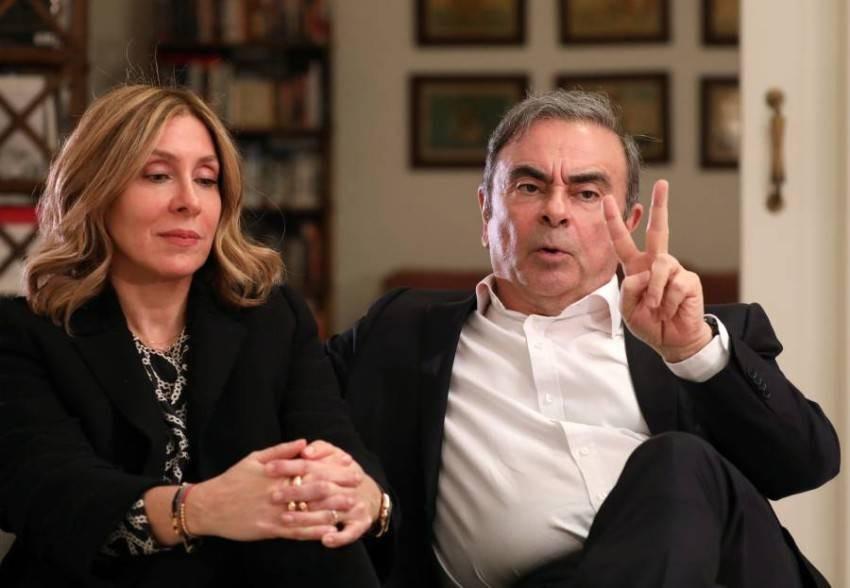 كارلوس غصن وزوجته - رويترز
