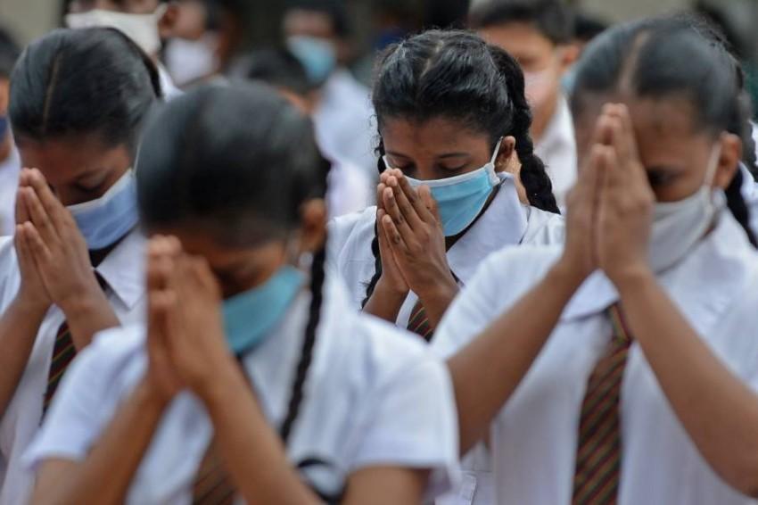 طلاب يعودون للمدارس في سريلانكا. (أ ف ب)