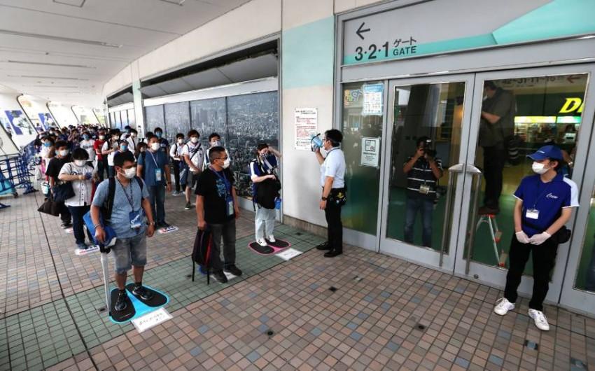 طوكيو تسجل أكثر من 200 إصابة بكورونا. (أ ف ب)