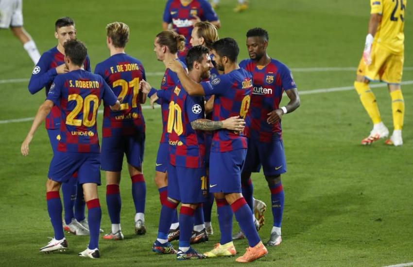 فرحة لاعبي برشلونة. (أ ب)