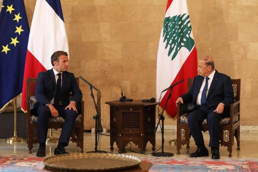 ميشال عون وإيمانويل ماكرون في لبنان. (رويترز)