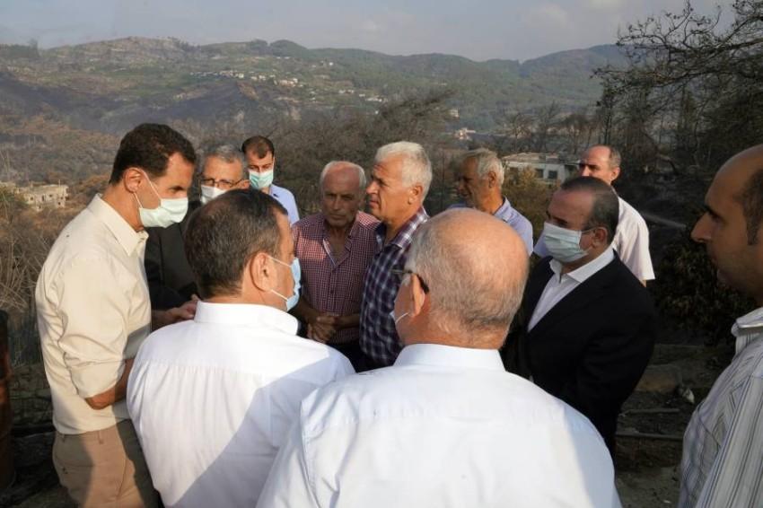 الأسد يتفقد أضرار الحرائق في اللاذقية - أ ب