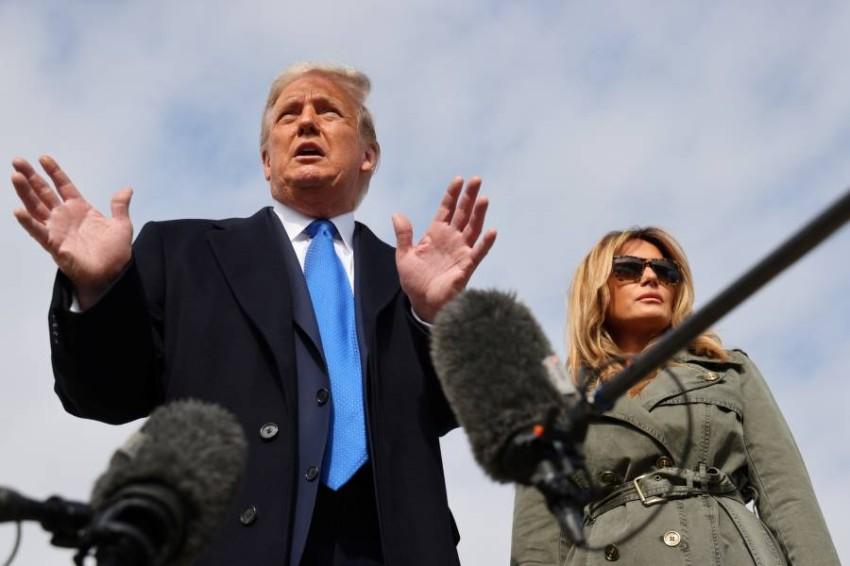 ترامب وزوجته ميلانيا في طريقهما لحضور تجمع انتخابي. (رويترز)