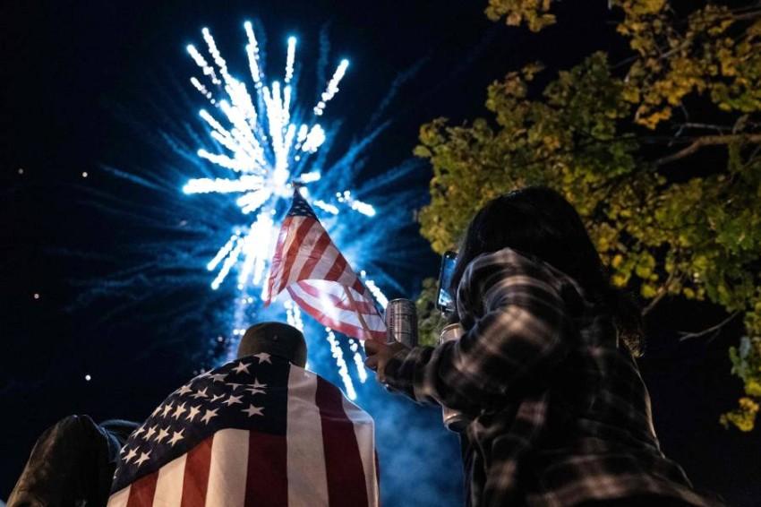 احتفالات الأمريكيين ببايدن. (أ ف ب)