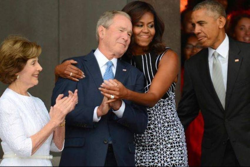 ميشيل أوباما وجورج بوش. (جيتي)