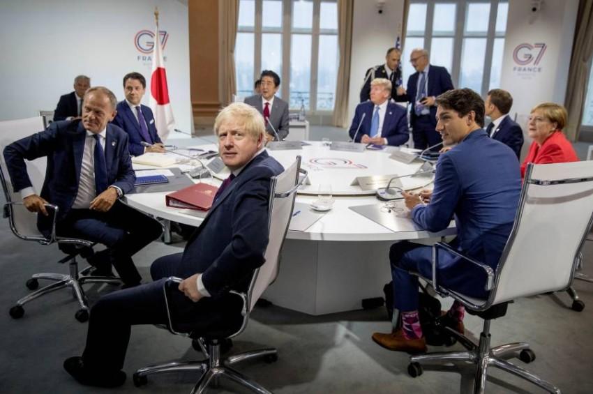 قادة دول مجموعة السبع خلال جلسة عمل في لقاء القمة في مدينة بياريتس الفرنسية في 2019 . (رويترز)