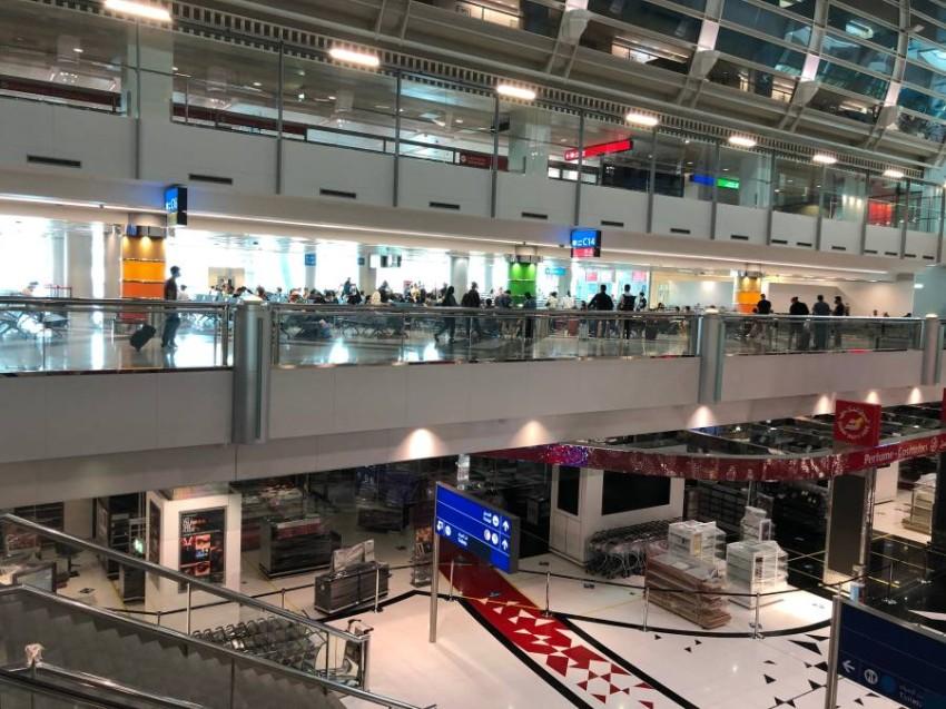 مسافرون في مطار دبي الدولي.