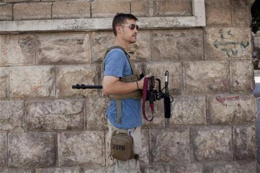 الصحفي الأمريكي جيمس فولي.. أحد ضحايا الخلية الإرهابية. (رويترز)