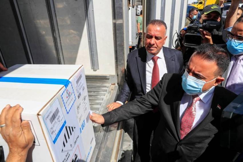 تلقى العراق أولى شحنات لقاح «فايزر» - رويترز.