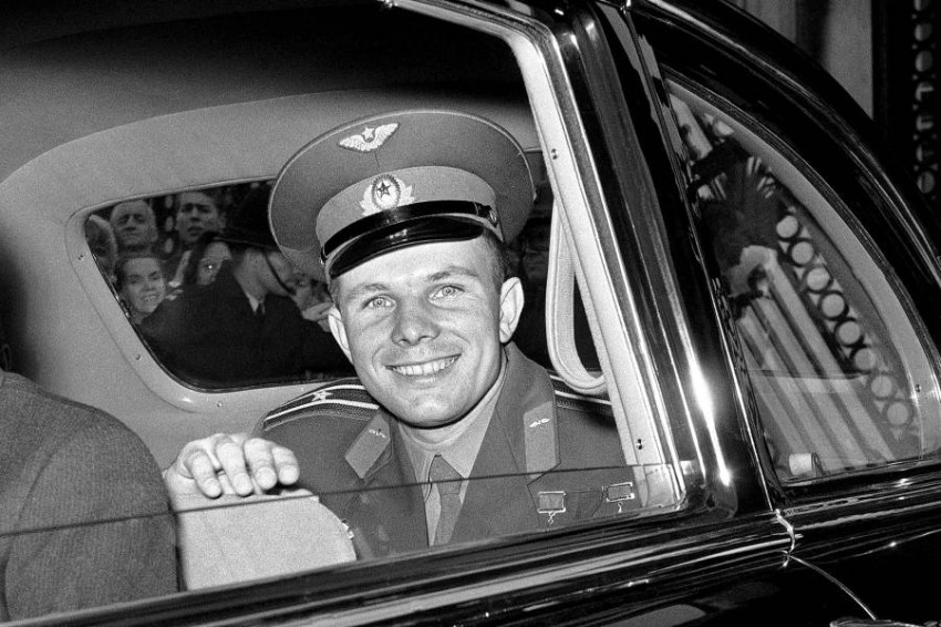 FILE - In this Friday, July 14, 1961 file photo, Major Yuri Gagarin, the Russian cosmonaut, smiles as he leaves Buckingham Palace in London, United Kingdom, after lunch with Queen Elizabeth II. He is visiting Britain in connection with the soviet exhibition in London. The successful one-orbit flight on April 12, 1961 made the 27-year-old Gagarin a national hero and cemented Soviet supremacy in space until the United States put a man on the moon more than eight years later. (AP Photo/Brian Calvert, File)