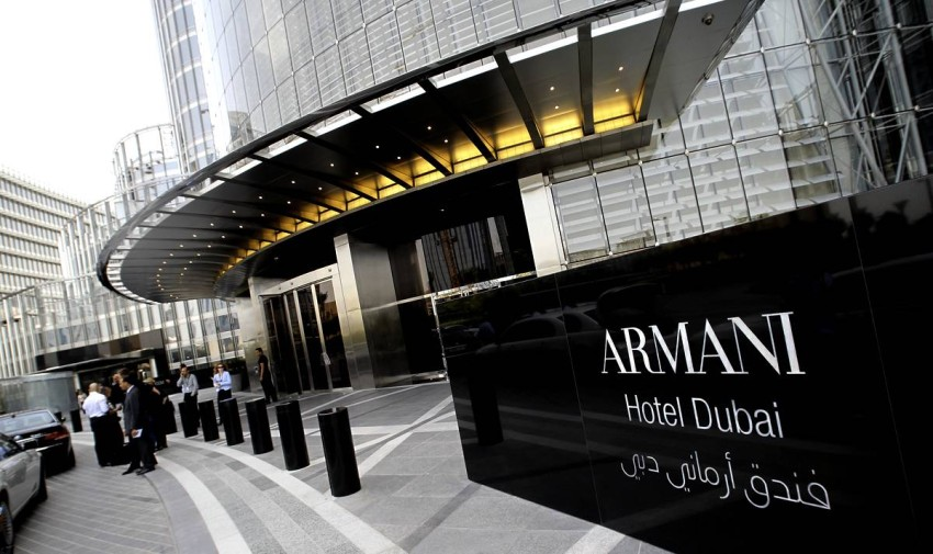 People stand outside Dubai's Armani hotel at the Gulf emirate's Burj Khalifa tower on April 27, 2010 just before its glitzy opening ceremony. The 160-room luxury hotel, crafted by designer Giorgio Armani, is the first landmark tenant in the world's tallest skyscraper. AFP PHOTO/KARIM SAHIB (Photo credit should read KARIM SAHIB/AFP/Getty Images)