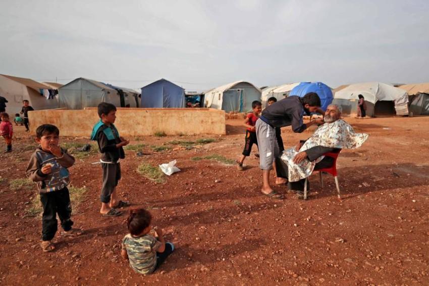 مخيم لسوريين شردتهم الحرب في إدلب شمال البلاد. (أ ف ب)