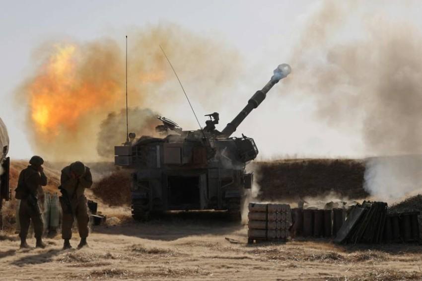 قوات إسرائيلية خلال قصف غزة. (أ ف ب)