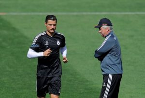 MADRID, SPAIN - MAY 12: Cristiano Ronaldo of Real Madrid runs past head coach Carlo Ancelotti during the Real Madrid CF training session ahead of the UEFA Champions League Semi Final, Second Leg against Juventus at Valdebebas training ground on May 12, 2015 in Madrid, Spain. (Photo by Denis Doyle/Getty Images)