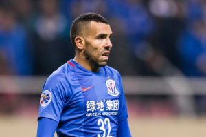 SHANGHAI, CHINA - FEBRUARY 08: Carlos Tevez of Shanghai Shenhua FC reacts during their AFC Champions League 2017 Playoff Stage match between Shanghai Shenhua FC (CHN) and Brisbane Roar (AUS) at the Hongkou Stadium, on 08 February 2017 in Shanghai, China. (Photo by Power Sport Images/Getty Images)